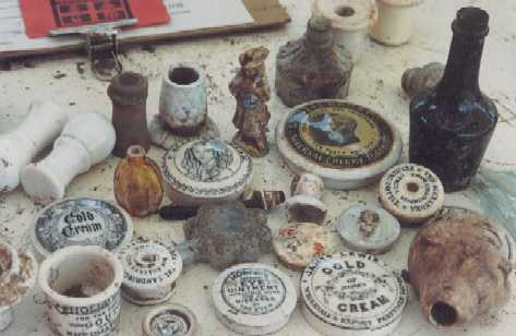 varied pot lids  miniature liquor and lids dolls heads glass and ceramic inks